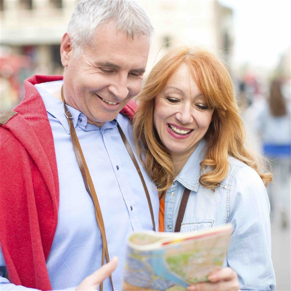 Couple Smiling looking at a map